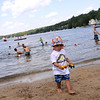 TIM JEAN/Staff photo. Benjamin Wood, 2, of Nashua who was visiting his grandparents in Windham plays with his trucks at the Windham Town Beach on Cobbetts Pond.     7/11/15