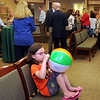 CARL RUSSO/Staff photo. Ribbon cutting ceremony/open house for expanded One-Stop Derry Medical Center in Windham. Abbi Maldonado, 6 of Salem plays with her beach ball during the open house reception.5/21/2015.
