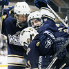 TIM JEAN/Staff photo<br /> Windham's Chad Desautels is swarmed by his teammates after scoring a goal against Bow during the NHIAA Boys D2 State Championship hockey game at the Verizon Wireless Arena. Windham defeated Bow 4-3.     3/19/16