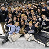TIM JEAN/Staff photo<br /> Windham High School hockey players pose on the ice after winning the NHIAA Boys D2 State Championship hockey game against Bow 4-3 at the Verizon Wireless Arena in Manchester.   3/19/16