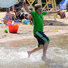 TIM JEAN/Staff photo. John Tamasi, 9, of Windham runs in to the water at the Windham Town Beach on Cobbetts Pond.     7/11/15
