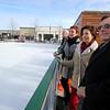 KEN YUSZKUS/Staff photo.   L-r ,  Ed Gallagher, Kristi St. Laurent, Laura Scott, and  Al Letizio, view the ice skating rink at MarketStreet in Lynnfield.     1/22/15
