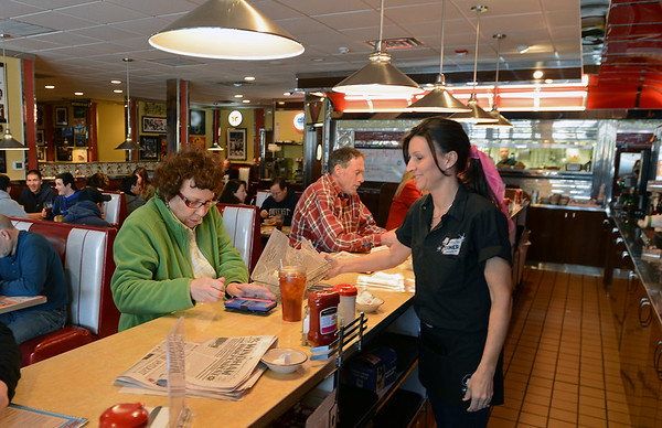 RYAN HUTTON/ Staff photo<br /> General Manager Sherry Latham serves a customer lunch at the old fashioned soda counter of Mary Ann's Diner of Windham.
