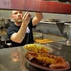RYAN HUTTON/ Staff photo<br /> Cook Justin Devoe serves up an order of eggs, home fries, bacon and toast during the lunch rush at Mary Ann's Diner of Windham.