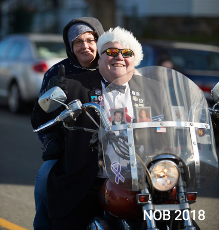 Joe Amore & Dawn Bartlett enjoy a ride through the Beverly Holiday Parade, Sunday, November 26, 2017. Jared Charney / Photo