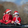 Timmy and Lilly Gentlemen watch the action of the Beverly Holiday Parade, Sunday, November 26, 2017. Jared Charney / Photo