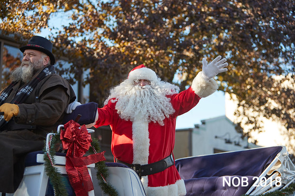 Santa waves to the crowd during the Beverly Holiday Parade, Sunday, November 26, 2017. Jared Charney / Photo