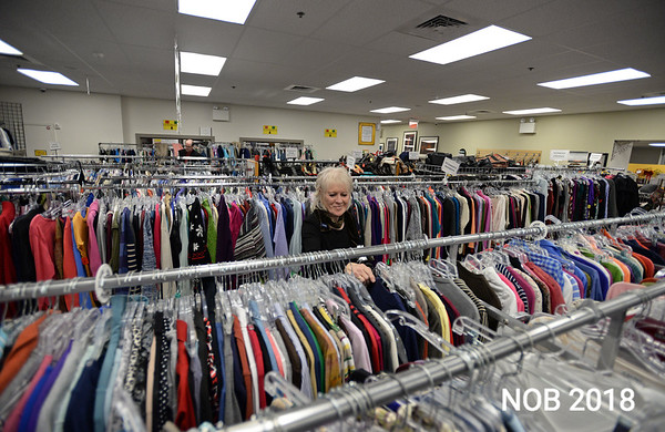 RYAN HUTTON/ Staff photo<br /> Rosa Padre organizes some of the clothing at the Beverly Bootstraps Thrift Shop during the shop's fundraising event on December 7.