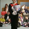 Gloucester: Carole Finn-Weidman, dressed as the Cat in the Hat reads Dr. Suess books at the Cat in the Hat Party at the Sawyer Free Library Saturday afternoon. Mary Muckenhoupt/Gloucester Daily Times Gloucester: Carole Finn-Weidman, dressed as the Cat in the Hat reads Dr. Suess books at the Cat in the Hat Party at the Sawyer Free Library Saturday afternoon. Mary Muckenhoupt/Gloucester Daily Times ORG XMIT: kze3z077