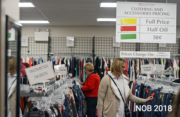 RYAN HUTTON/ Staff photo<br /> Michelle Dove, right, browses the clothing section of the Beverly Bootstraps Thrift Shop during the shop's fundraising event on December 7.