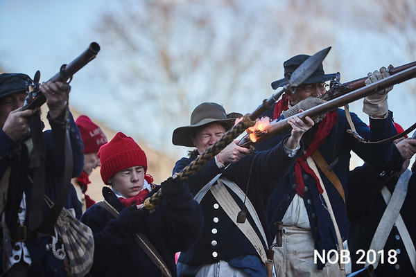 Firing off members of General Glover's Regiment during  the Beverly Holiday Parade, Sunday, November 26, 2017. Jared Charney / Photo