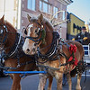 Horses pull Santa along the Beverly Holiday Parade, Sunday, November 26, 2017. Jared Charney / Photo
