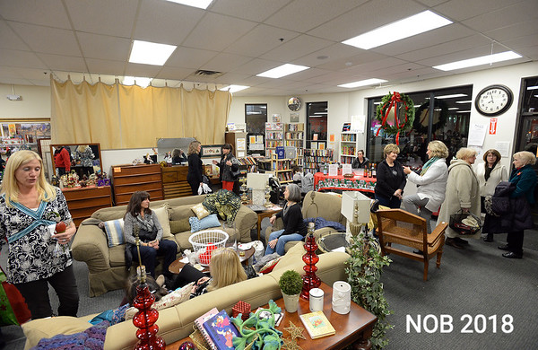 RYAN HUTTON/ Staff photo<br /> People relax during the Beverly Bootstraps Thrift Shop's fundraising event on December 7.