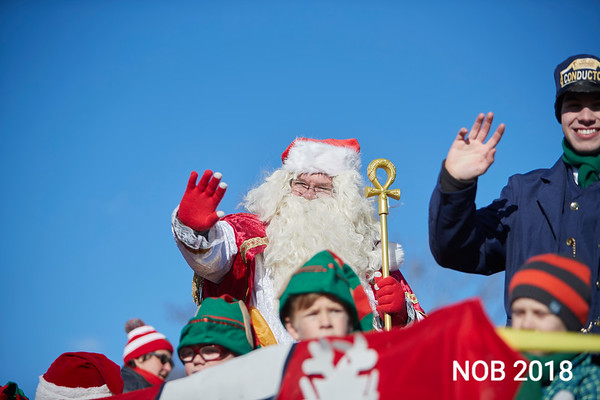Multiple Santas graced the floats during the Beverly Holiday Parade, Sunday, November 26, 2017. Jared Charney / Photo