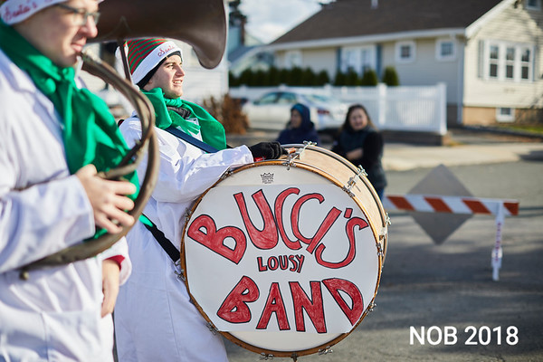Members of the Bucci's Lousy Band perform holiday songs during the Beverly Holiday Parade, Sunday, November 26, 2017. Jared Charney / Photo