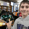 The Leominster and Fitcburg Public Library's held the championship round of their Magic The Gathering tournament on Saturday, Jan. 25, 2020 at the Fitchburg Public Library. The final match for the number one spot was between Chase Pratt-Bouchard, 11 in Gray, and Sebastian Cordio, 18, both from Leominster. Chase was the winner and shows off the six packs of magic cards he got. SENTINEL & ENTERPRISE/JOHN LOVE