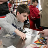 The Leominster and Fitcburg Public Library's held the championship round of their Magic The Gathering tournament on Saturday, Jan. 25, 2020 at the Fitchburg Public Library. The final match for the number one spot was between Chase Pratt-Bouchard, 11 in Gray, and Sebastian Cordio, 18, both from Leominster. SENTINEL & ENTERPRISE/JOHN LOVE