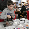 The Leominster and Fitcburg Public Library's held the championship round of their Magic The Gathering tournament on Saturday, Jan. 25, 2020 at the Fitchburg Public Library. The final match for the number one spot was between Chase Pratt-Bouchard, 11 in Gray, and Sebastian Cordio, 18, both from Leominster. Chase tries to decide what his next move will be. SENTINEL & ENTERPRISE/JOHN LOVE