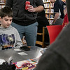 The Leominster and Fitcburg Public Library's held the championship round of their Magic The Gathering tournament on Saturday, Jan. 25, 2020 at the Fitchburg Public Library. The final match for the number one spot was between Chase Pratt-Bouchard, 11 on left, and Sebastian Cordio, 18 in hood, both from Leominster. Chase looks over his cards trying to decide which cards to play. SENTINEL & ENTERPRISE/JOHN LOVE