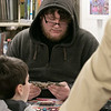 The Leominster and Fitcburg Public Library's held the championship round of their Magic The Gathering tournament on Saturday, Jan. 25, 2020 at the Fitchburg Public Library. The final match for the number one spot was between Chase Pratt-Bouchard, 11, and Sebastian Cordio, 18 in hood, both from Leominster. Sebastian takes his turn. SENTINEL & ENTERPRISE/JOHN LOVE