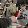 The Leominster and Fitcburg Public Library's held the championship round of their Magic The Gathering tournament on Saturday, Jan. 25, 2020 at the Fitchburg Public Library. The final match for the number one spot was between Chase Pratt-Bouchard, 11 on right, and Sebastian Cordio, 18 in hood, both from Leominster. Chase watches as Sebastian takes his turn. SENTINEL & ENTERPRISE/JOHN LOVE