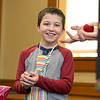 Aaron Trainque, 8, of Leominster helps magician Todd Migliacci with his magic trick of turning a small ball into a large ball on Tuesday February 21, 2017 at the Leominster Public Library. SENTINEL & ENTERPRISE/JOHN LOVE