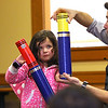 Abigail Caswell, 6, of Leominster helps magician Todd Migliacci with his magic trick on Tuesday February 21, 2017 at the Leominster Public Library. SENTINEL & ENTERPRISE/JOHN LOVE
