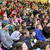 299 kids and their parents visited the Leominster Public Library to see magician Todd Migliacci do some magic trick on Tuesday February 21, 2017. SENTINEL & ENTERPRISE/JOHN LOVE
