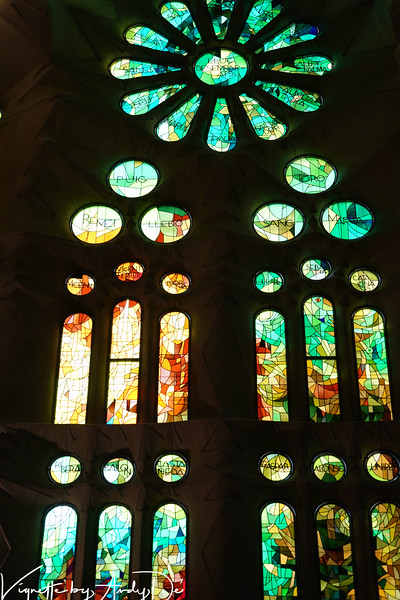 Exquisite stained glass windows lend a magical halo to this architectural marvel by the Maestro Antoni Gaudi!