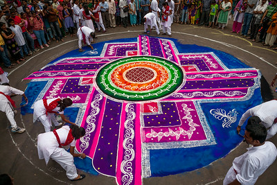 Huge Rangolis like these, drawn by several artists working in sync adorn the streets of Pune during Ganesh festival. The entire city gets on the streets, dancing, swaying to the beats of the energising musical procession. It is a celebration of their art, history and culture.