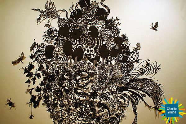 Look at the detail using hand-cut black paper.