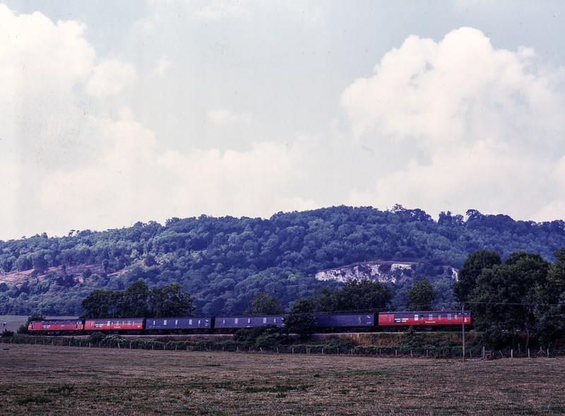 47745 passes through the countryside near Brockham with 1S81, <br /> the 13:24 Tonbridge - Glasgow Mail, on 16th August 1996. Scanned transparency.