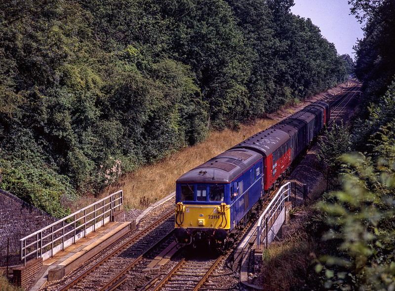 73114 crosses over Edenbridge Tunnel with 1S81, the 13:24 Tonbridge - Glasgow Mail, <br /> on 16th August 1996. Scanned transparency.