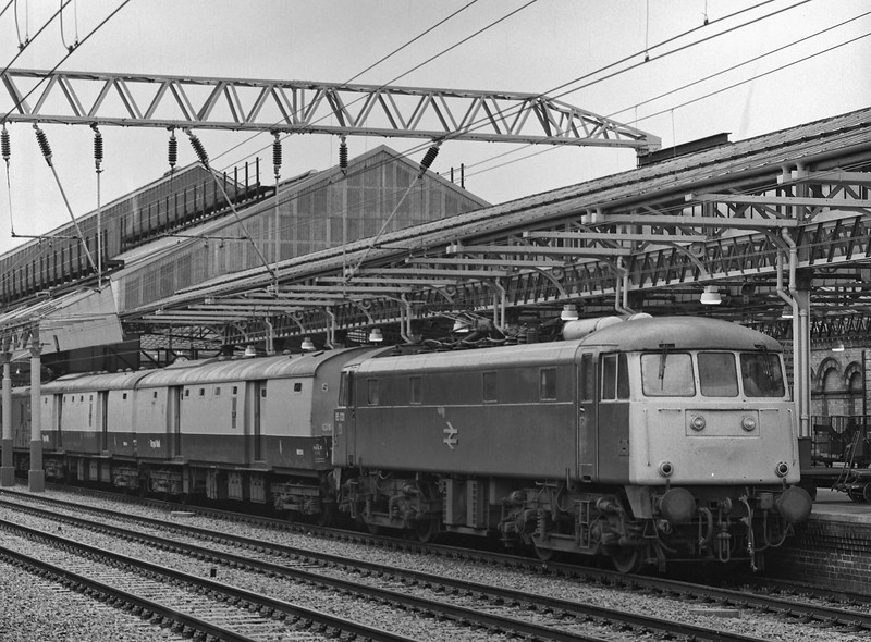 85031 at Crewe with TPO empties on 20th August 1985. Scanned negative.
