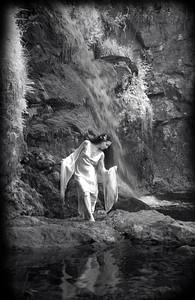 She Stood Beneath the Raging Falls