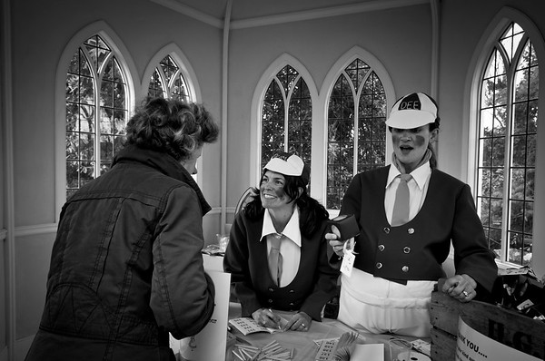 A woman buying raffle tickets from a stall in Rococo Garden, Painswick, Gloucestershire