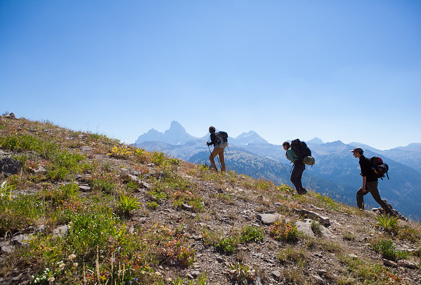 A team of archaeologists hike towards base camp in the Teton Range, Wyoming
