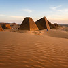 The single security guard for the entire site of Meroe conducts a round before sunset
