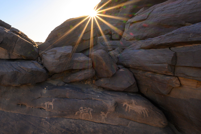Rock art at Sabu depicting people on horseback hunting an ostrich.