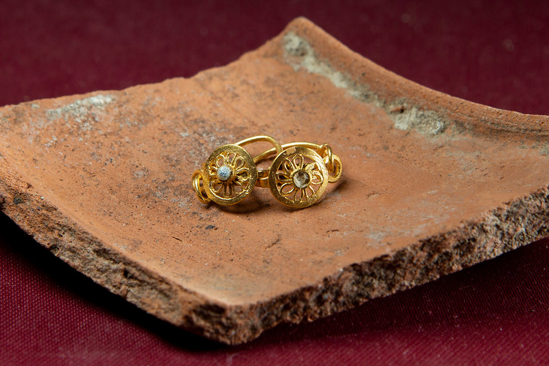 Gold earrings found in a child burial at the Vagnari cemetery.