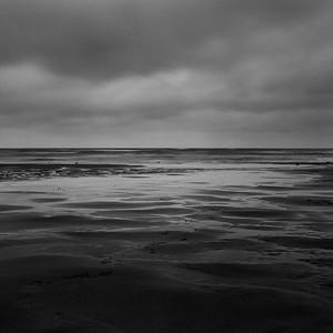 Sandy beach & sky, East Sussex