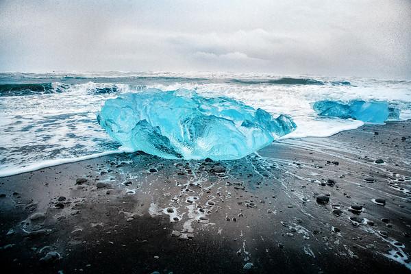 A blue iceberg washed ashore at Jokulsarlon, Diamond Beach, Iceland