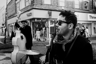 Buskers singing and playing musical instruments