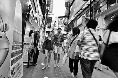 Crowded street in the evening in the popular shopping district of Myeongdong in Seoul