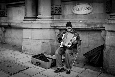 Street musician playing the accordion, Bristol
