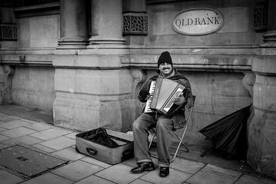 Street musician playing the accordion, Bristol
