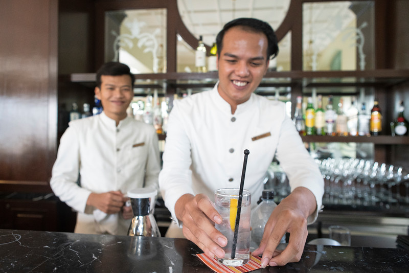 A bartender presents a Malacca Gin and Tonic at the Majestic Hotel Bar in Malacca, Malaysia. This is the rarest gin and tonic in the world and only 200 bottles are prodeced each year and can only be tasted at the historic Majestic Hotel Bar. The botanicals in the Malacca gin can only be acquired in Malaysia and were hand picked by Charles Tanqueray when he used to visit the town in the late 1800s.