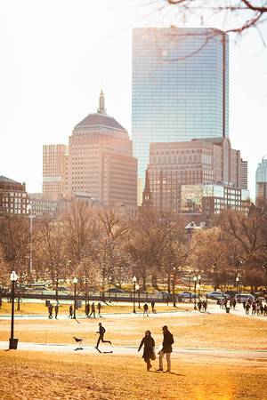 People walk through the Boston Common during a sunny winter day