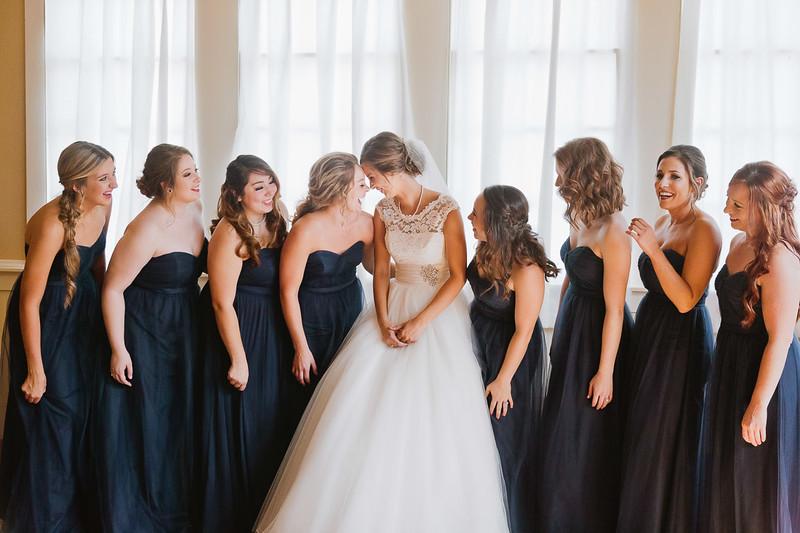 Bride and bridesmaid wedding prep