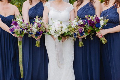 Bride and bridesmaids during bridal portrait in Houston, TX